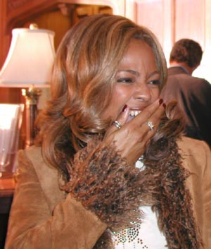 Kim Fields laughing.