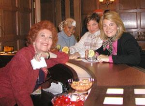The girls and Mrs. Garrett in the restaurant lounge.